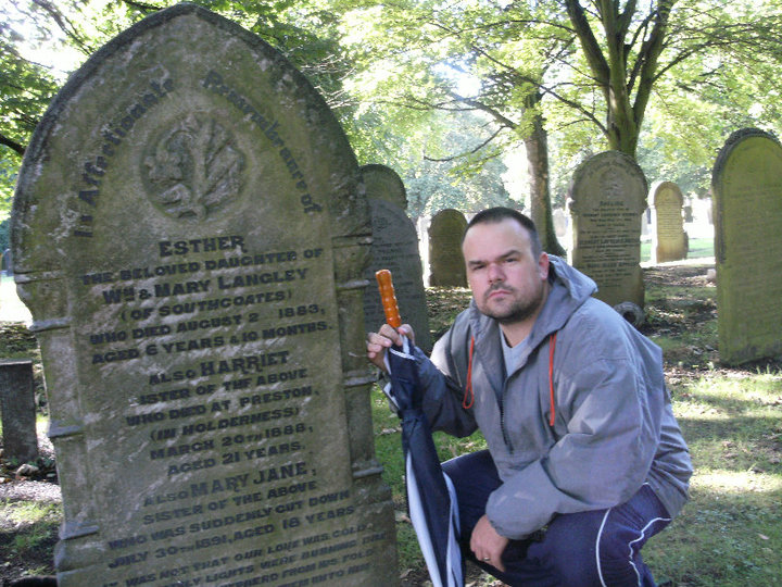 Mike Covell and the gravestone of Mary Jane Langley