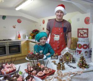 Jacob and Daniel serve the Christmas goodies!