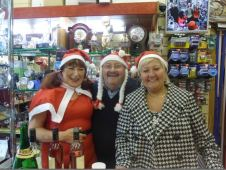 Linda, Graham and Marjorie show Christmas hospitality at Rings 'n' Things