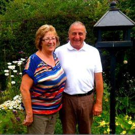 Mavis and Derek Rosindale in garden sq