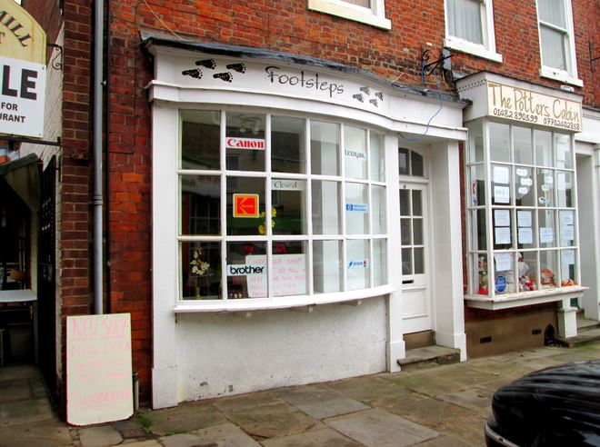 Former Hedon Inks & Toners - with sign writing removed showing previous Footsteps signage
