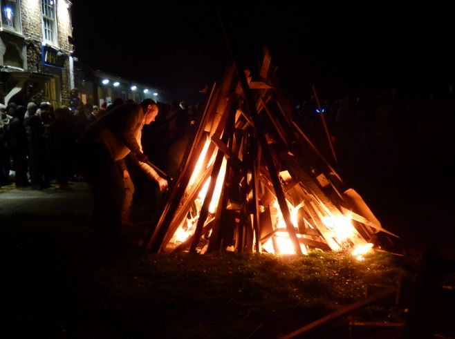 Landlord Mark Hawksworth lights the Haven bonfire