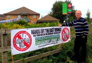 John Dennis and Hands Off banner