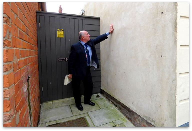 Councillor Mike Bryan shows where the defibrillator will be located at the Town Hall