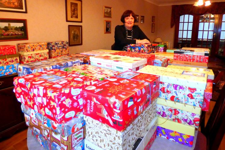 Brenda with some of the 150 donated shoeboxes
