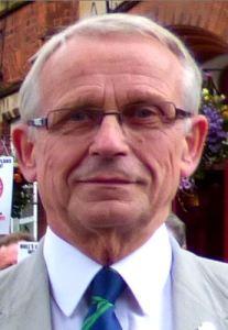John Dennis not smiling