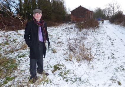 Terry West at the land behind the railway yard which he believes could be a 40-45 place car parking area