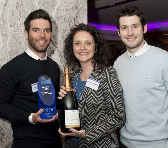Laurence, Elizabeth and Jonathan Garton with the Award