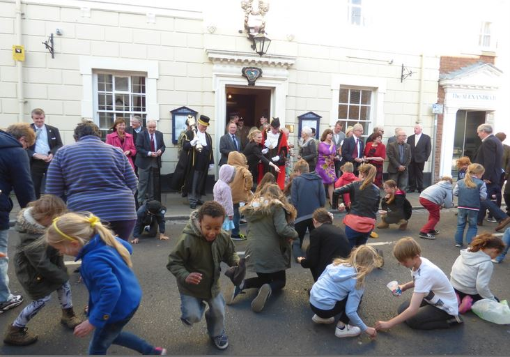 Traditional scramble for pennies at the Hedon Penny Throwing