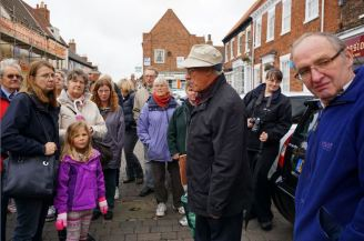 Dr Craven (centre) in the Hedon Market Place (at the feet of the audience is the bull ring to which animals were tethered during ancient cattle markets.