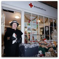 In traditional costume at the Red Cross shop