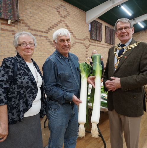 John Newby and his giant leeks with the Hedon Mayor and Mayoress (Mrs Linda Black)