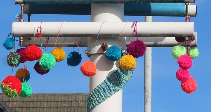 Yarn bombed pom poms